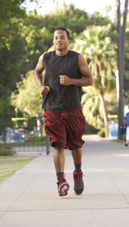 Young Man Jogging On Street photo