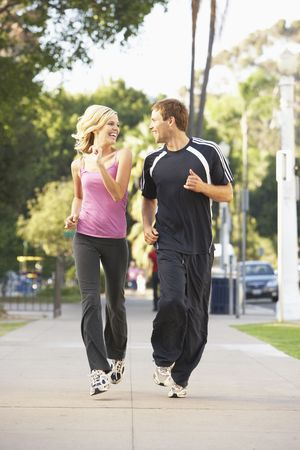 Young Couple Jogging On Street photo