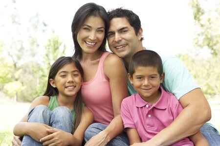 Portrait Of Young Family In Park Banco de Imagens - 6135743