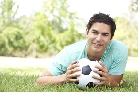 Portrait Of Young Man In Park With Football photo