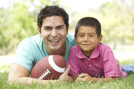 Father And Son In Park With American Football Stock Photo - 6128170