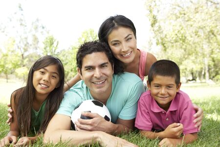 Family In Park With Football Banco de Imagens - 6135298