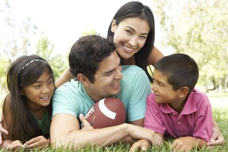 family garden: Family In Park With American Football