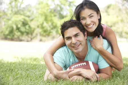 Couple In Park With American Football photo