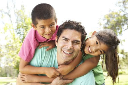 Father With Children In Park photo