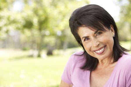 Portrait Of Senior Woman In Park photo