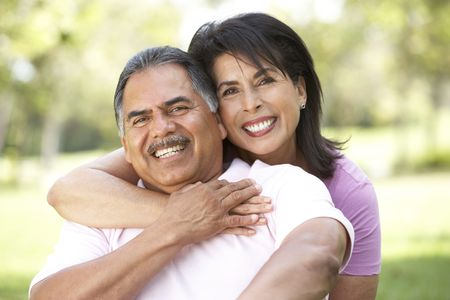 hispanic women: Portrait Of Senior Couple In Park Stock Photo