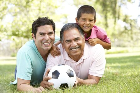 Grandfather With Son And Grandson In Park With Football Stock Photo - 6128124