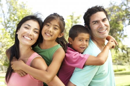 Young Family Having Fun In Park Stock Photo - 6142733