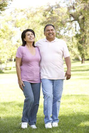 rid: Senior Couple Walking In Park