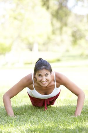 Young Woman Exercising In Park photo