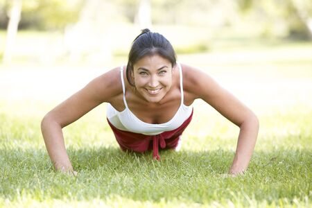 Young Woman Exercising In Park Stock Photo - 6127915
