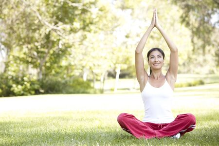Young Woman Doing Yoga In Park Stock Photo - 6135235