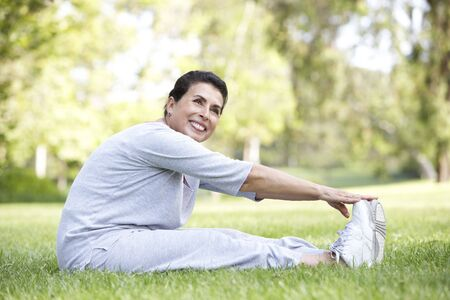 Senior Woman Exercising In Park photo