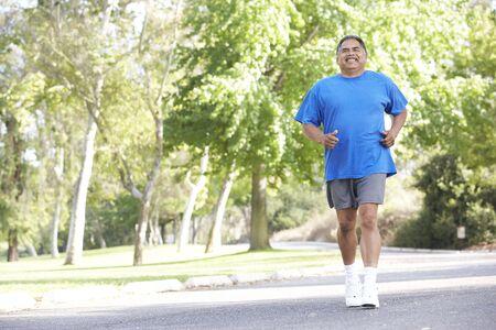 Senior Man Jogging In Park photo