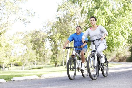 Senior Couple Cycling In Park photo