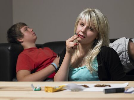 Teenage Couple Taking Drugs At Home photo