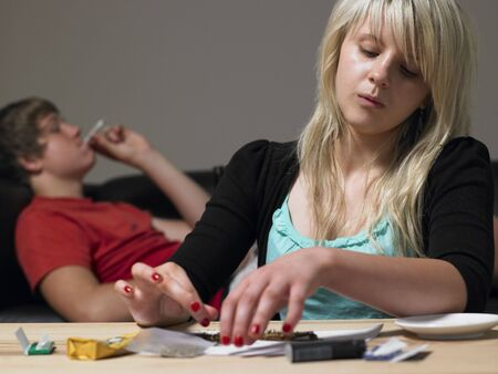 Teenage Couple Taking Drugs At Home Stock Photo - 6142888