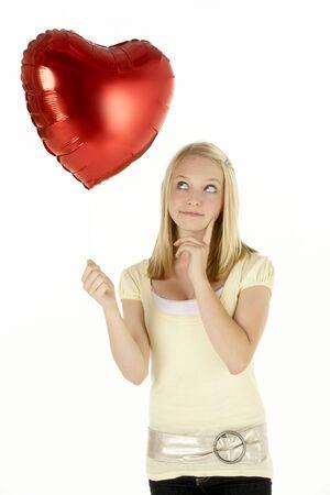 Teenage Girl Holding Heart-Shaped Balloon Stock Photo - 6372154