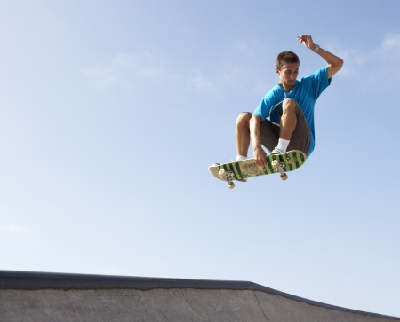 skateboarding: Teenage Boy In Skateboard Park Stock Photo