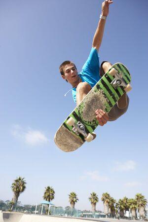 skateboarding tricks: Teenage Boy In Skateboard Park Stock Photo