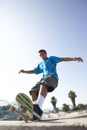 extreme angle: Teenage Boy In Skateboard Park Stock Photo
