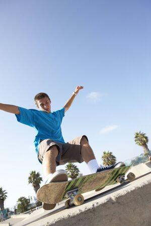 skateboarder: Teenage Boy In Skateboard Park Stock Photo