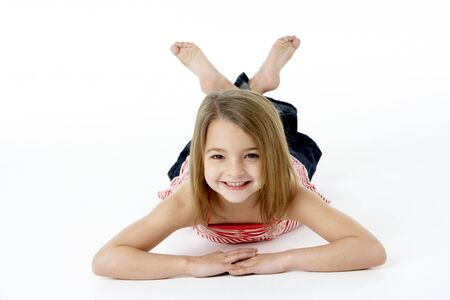 lying on stomach: Young Girl Lying On Stomach In Studio