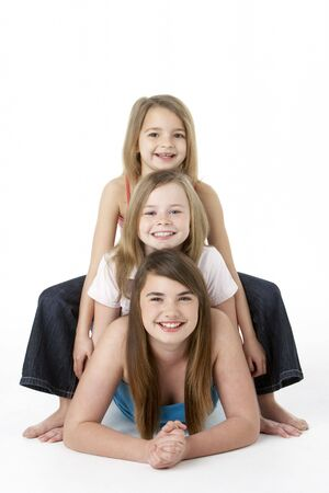 7 year old girl: Three Girls laying On Stomach In Studio