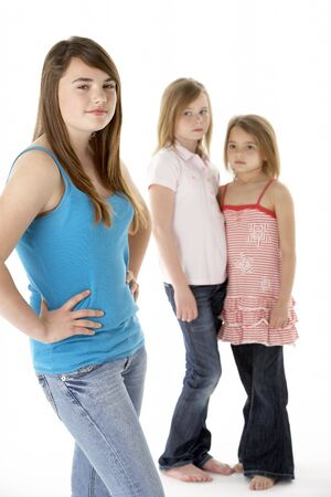 7 year old girl: Group Of Girls Together In Studio Looking Unhappy