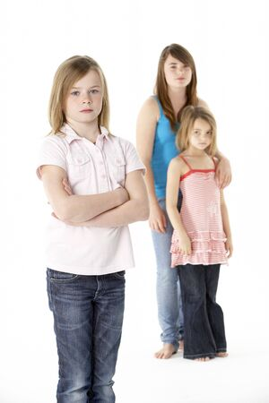 Group Of Girls Together In Studio Looking Unhappy