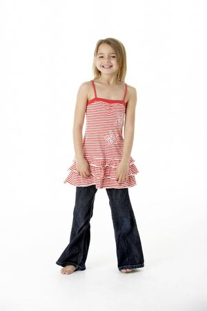 7 year old girl: Young Girl Standing In Studio
