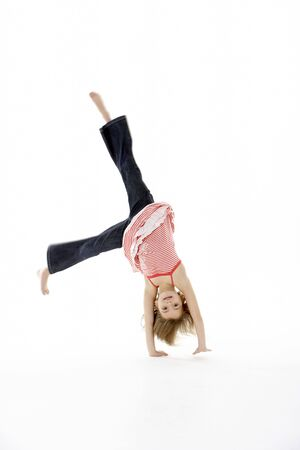 7 year old girl: Young Girl In Gymnastic Pose Doing Cartwheel
