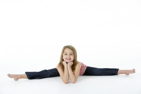Young Girl In Gymnastic Pose Doing Splits photo