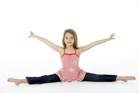 7 year old girl: Young Girl In Gymnastic Pose Doing Splits