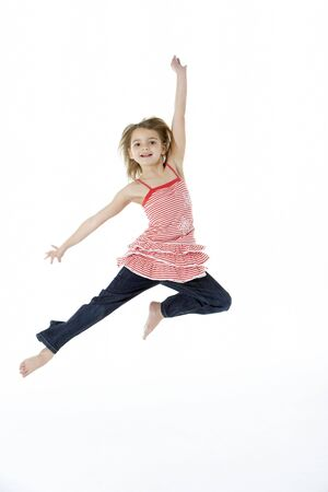 Young Girl Jumping In Mid Air photo
