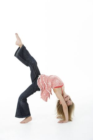 backflip: Young Girl Doing Backflip In Studio