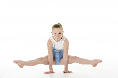 young to old: Studio Portrait Of Young Female Gymnast Stock Photo