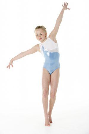 7 year old girl: Studio Portrait Of Young Female Gymnast Stock Photo