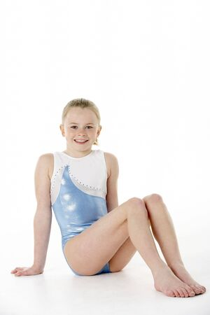 gymnastics girl: Studio Portrait Of Young Female Gymnast Stock Photo