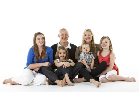 Shot Of Family Group Sitting In Studio Stock Photo - 6456140