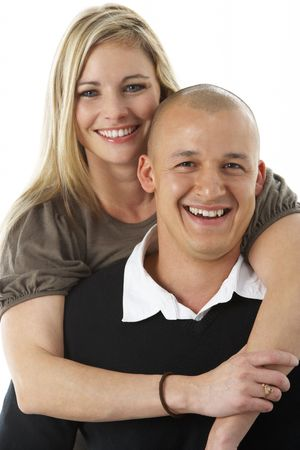 Studio Portrait Of Young Couple Hugging photo