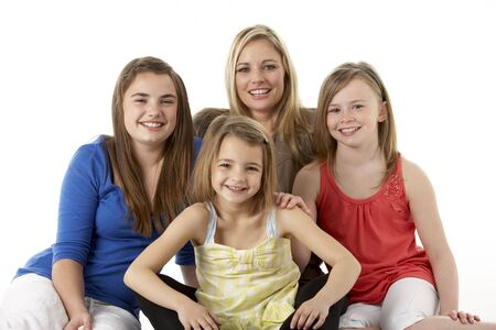 Studio Portrait Of Mother Hugging Daughters photo