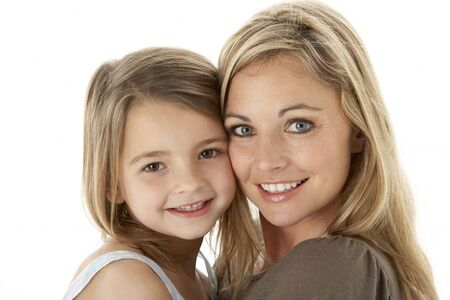 Studio Portrait Of Mother Hugging Young Daughter Stock Photo - 6456097