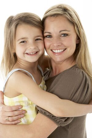 Studio Portrait Of Mother Hugging Young Daughter Stock Photo - 6456531