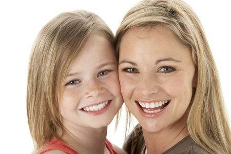 Studio Portrait Of Mother Hugging Young Daughter photo
