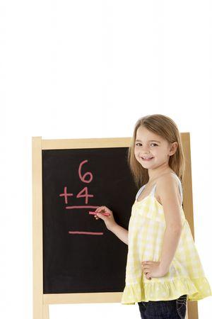 7 year old girl: Young Girl Writing On Blackboard