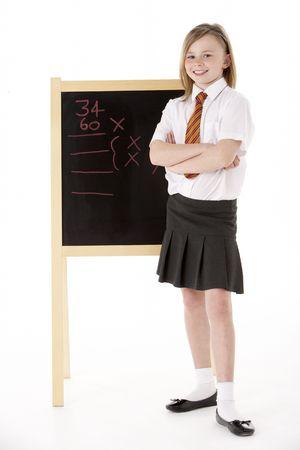 11 year old: Thoughtful Female Student Wearing Uniform Next To Blackboard