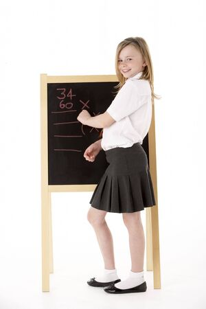 school uniform girl: Thoughtful Female Student Wearing Uniform Next To Blackboard