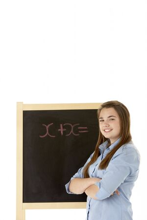 Female Student Standing Next To Blackboard photo